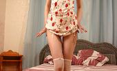 Nylon Charm A Girl In Short Dress Demonstrates Her White Stockings Nylon Charm