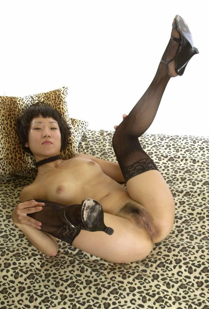 Asian Sex Thrills 559095 Chinky Smooth Asian In BDSM Suit Lustfully Esposing And Revealing Her Cunt Asian Sex Thrills