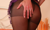 ePantyhose Land Anna Long-Legged Girl In Black Control Top Hose Shows Her Nyloned Pink Close-Up ePantyhose Land
