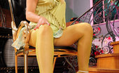 ePantyhose Land Flossie Blonde Teaser Playfully Shows Off Her Bright Green And Violet Fashion Hose ePantyhose Land