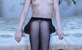 ePantyhose Land Crystal Tempting Hottie Boasting Her Glamorous Dark Back Seam Pantyhose On The Bed ePantyhose Land