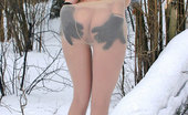 ePantyhose Land Alice Gorgeous Chick In Winter Outfit And White Pantyhose Playing In The Forest ePantyhose Land