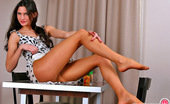 ePantyhose Land Gwendolen Teasing Chick In Seducing Flesh-Colored Pantyhose Posing Right On The Table ePantyhose Land