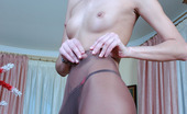 ePantyhose Land Cora Nasty Chick Inspects Her Control Top Pantyhose Before Putting On Her Skirt ePantyhose Land