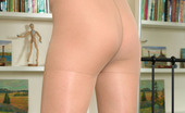 ePantyhose Land Corolina Slim Girl Displays Her Mile-Long Legs Covered By Light Grey Sheer Pantyhose ePantyhose Land