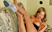 ePantyhose Land Cora Upskirt Chick Revealing Her Pantyhose Clad Legs In All Positions Possible ePantyhose Land