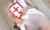 ePantyhose Land Judith Lewd Nurse In White Pantyhose Dropping On Her Knees While Fingering Pussy ePantyhose Land