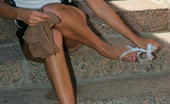 ePantyhose Land Edna Frisky Brunette Peeling Off Panties And Putting On Shiny Hose On The Stairs ePantyhose Land