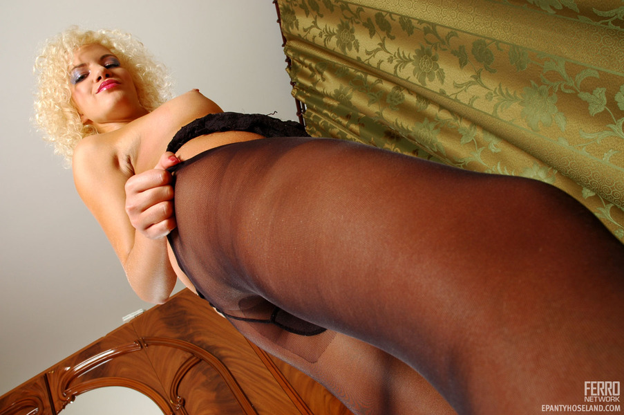 trudy leggy blondie rubbing her perky nipples with hands clad in black
