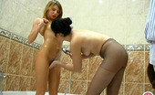 ePantyhose Land Rosa & Alice Sultry Chicks Licking A Clit Through Their Wet Pantyhose Right In Bathroom ePantyhose Land