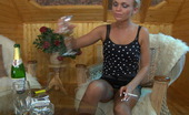 ePantyhose Land Dolly Heated Blonde Drinks Champagne And Fingers Her Pussy Thru Soft Brown Tights ePantyhose Land