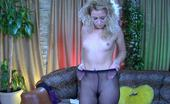 ePantyhose Land Gertrude Curly Blond Babe Posing By The Mirror In Her Back Seam And Suspender Tights ePantyhose Land