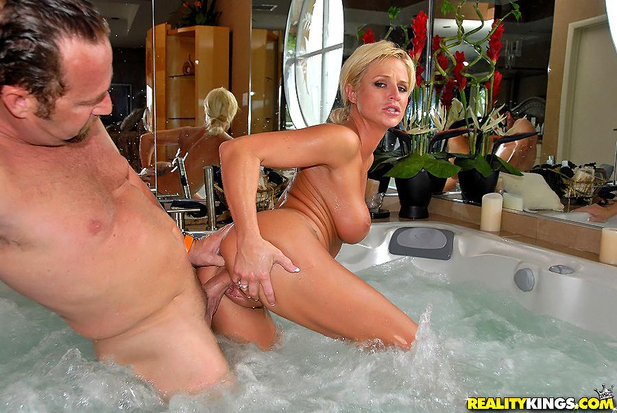 Curvy milf seduces a young dude for a hot tub fuck